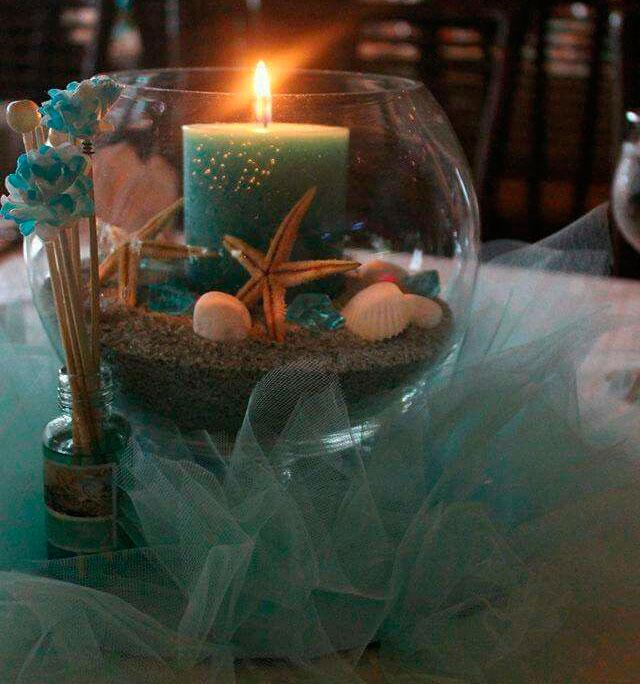 Centro de mesa temático para bodas en la playa